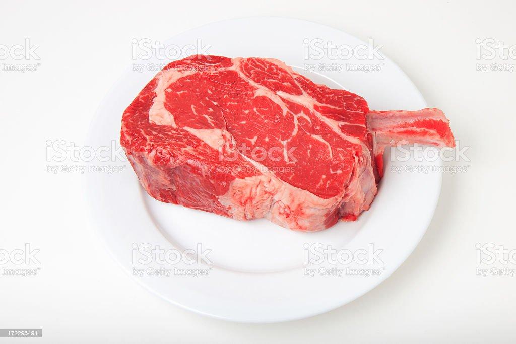 Raw Cowboy Ribeye 5 (White Plate) stock photo