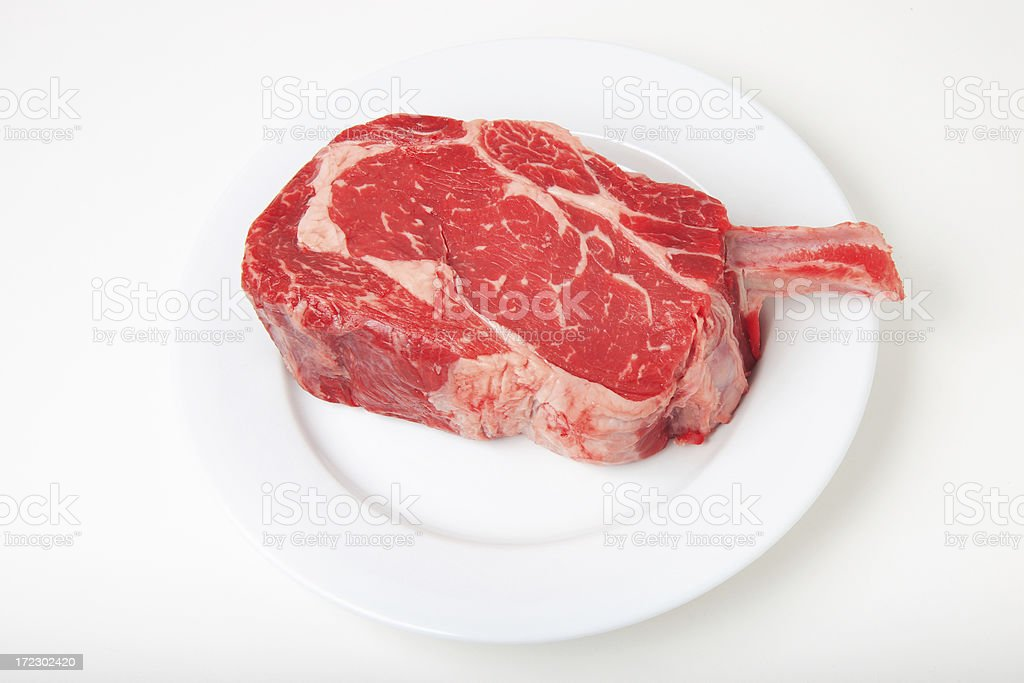 Raw Cowboy Ribeye 8 (White Plate) stock photo