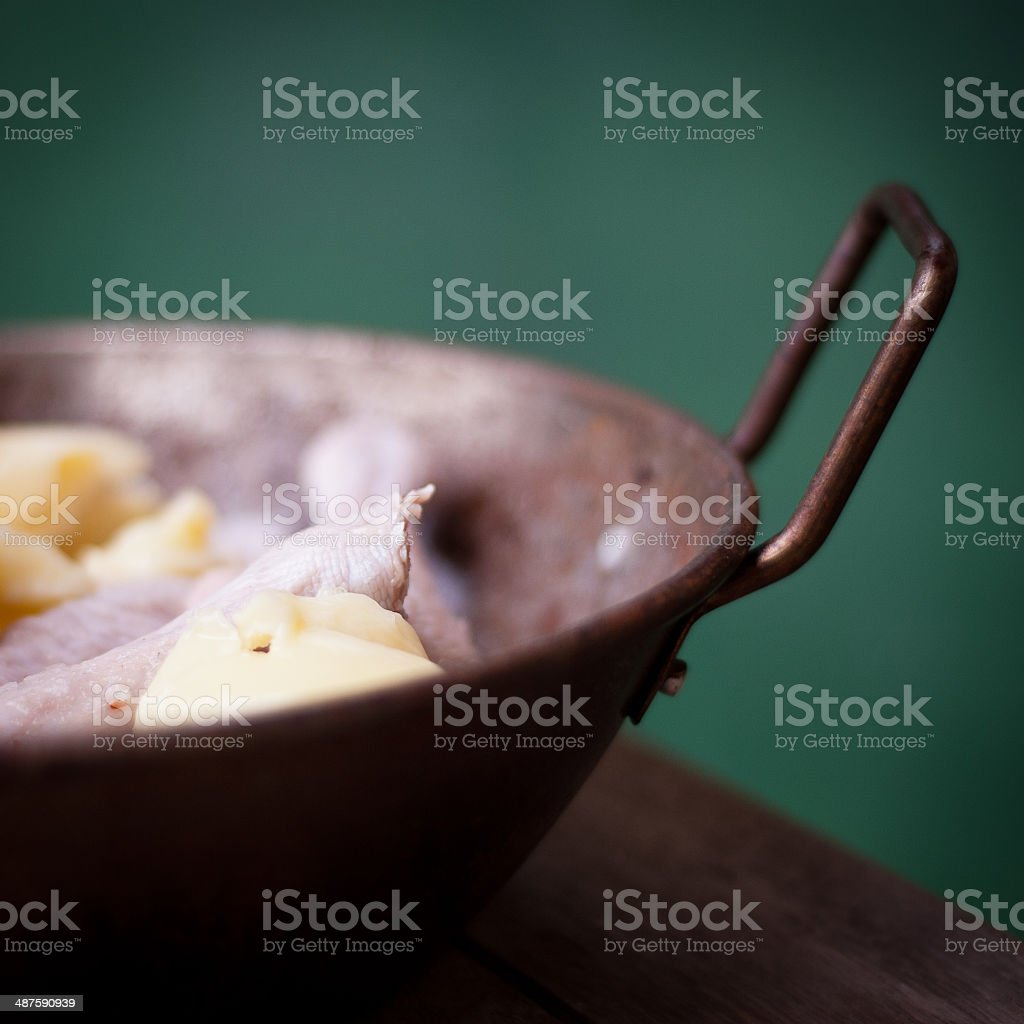 Raw duck legs for roasting in a pan stock photo