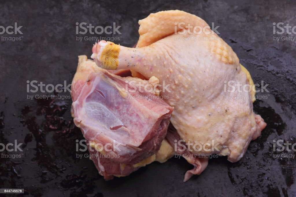 Raw duck meat on a dark background before cooking stock photo