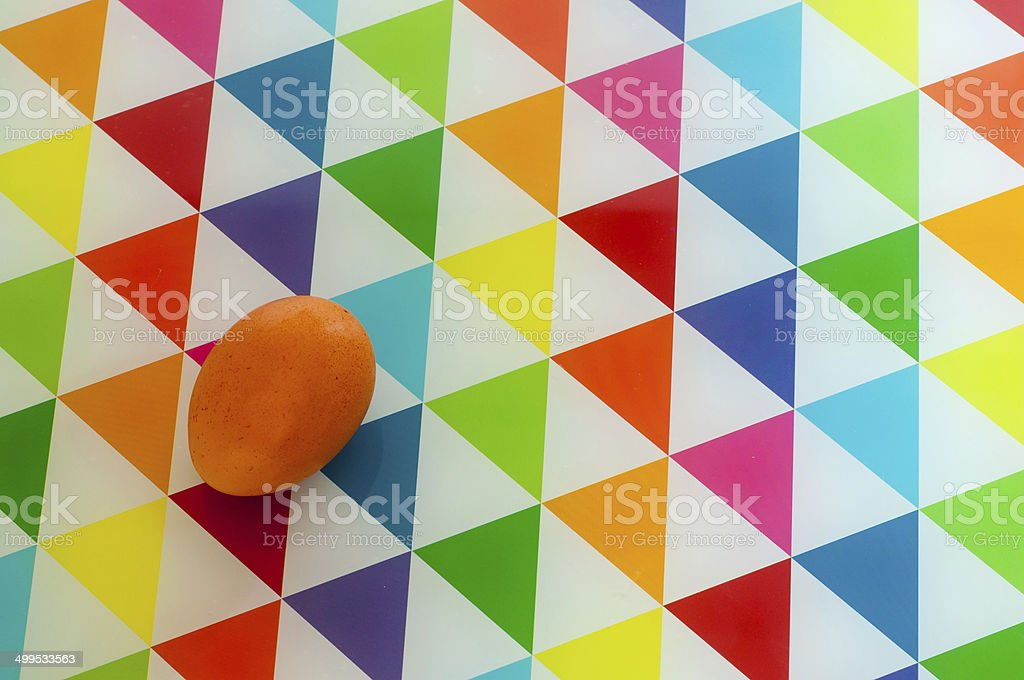 Raw egg on color background royalty-free stock photo