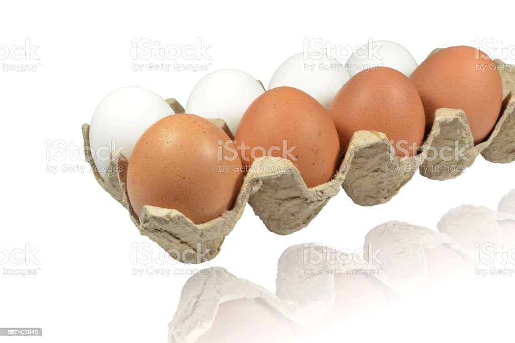 Raw eggs lie in container of porous cardboard stock photo