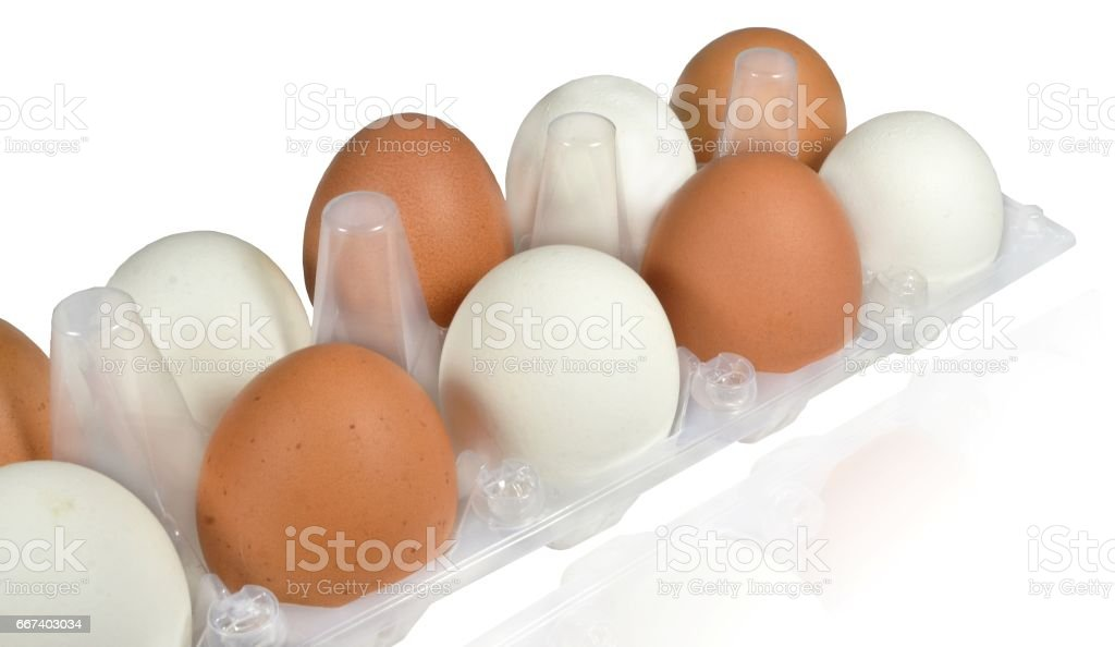Raw eggs of white and brown color stock photo