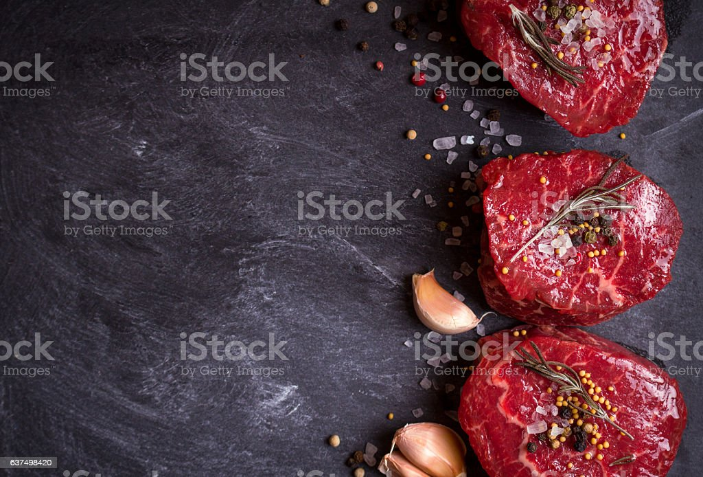 Raw filet mignon steaks with spices stock photo