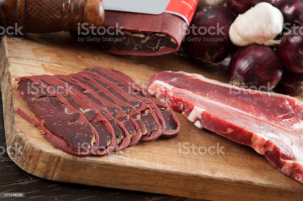 Raw fillet steak and bacon slices royalty-free stock photo
