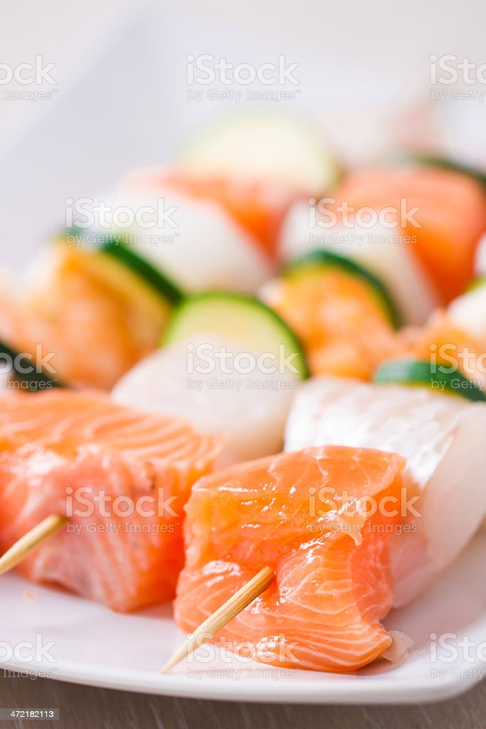Raw Fish skewers stock photo