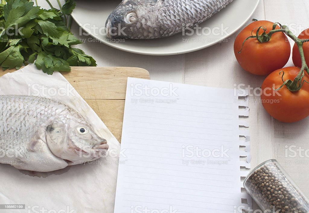 Raw fish with paper for recipe royalty-free stock photo
