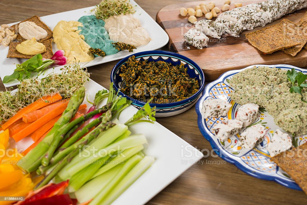 Raw food - crunchy vegetables  and nutcheese stock photo