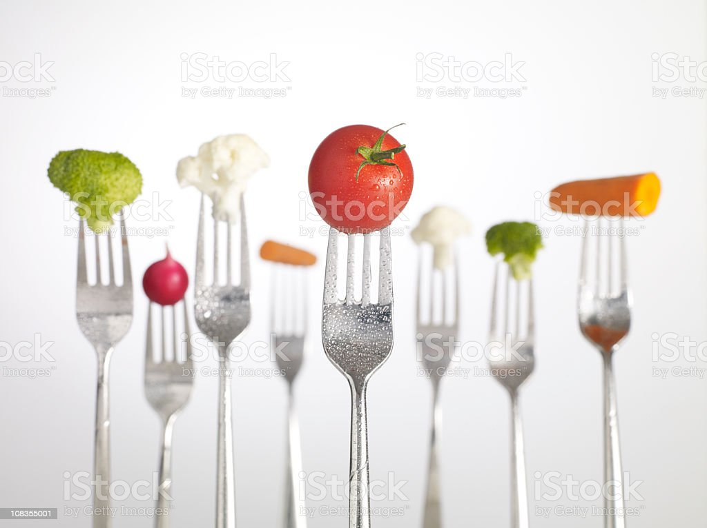 Raw Food on forks stock photo