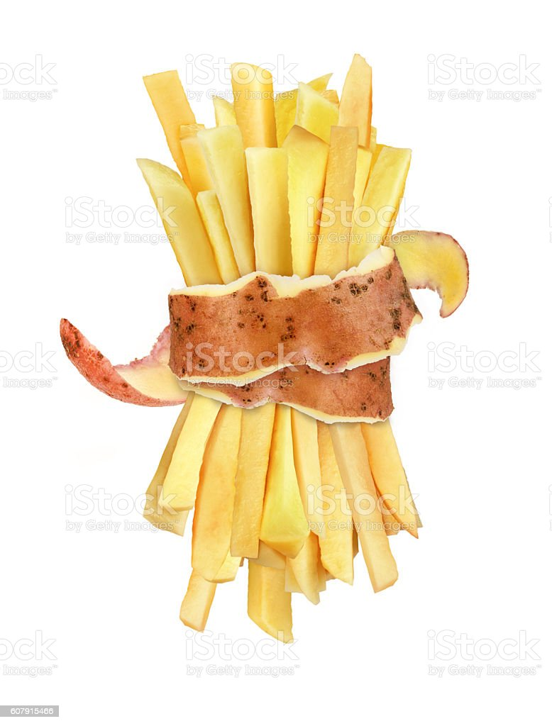 raw french fries in the peel stock photo