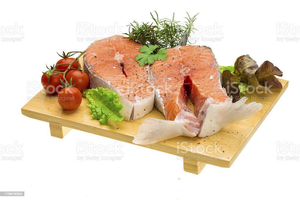 Raw fresh bright salmon with vegetables royalty-free stock photo
