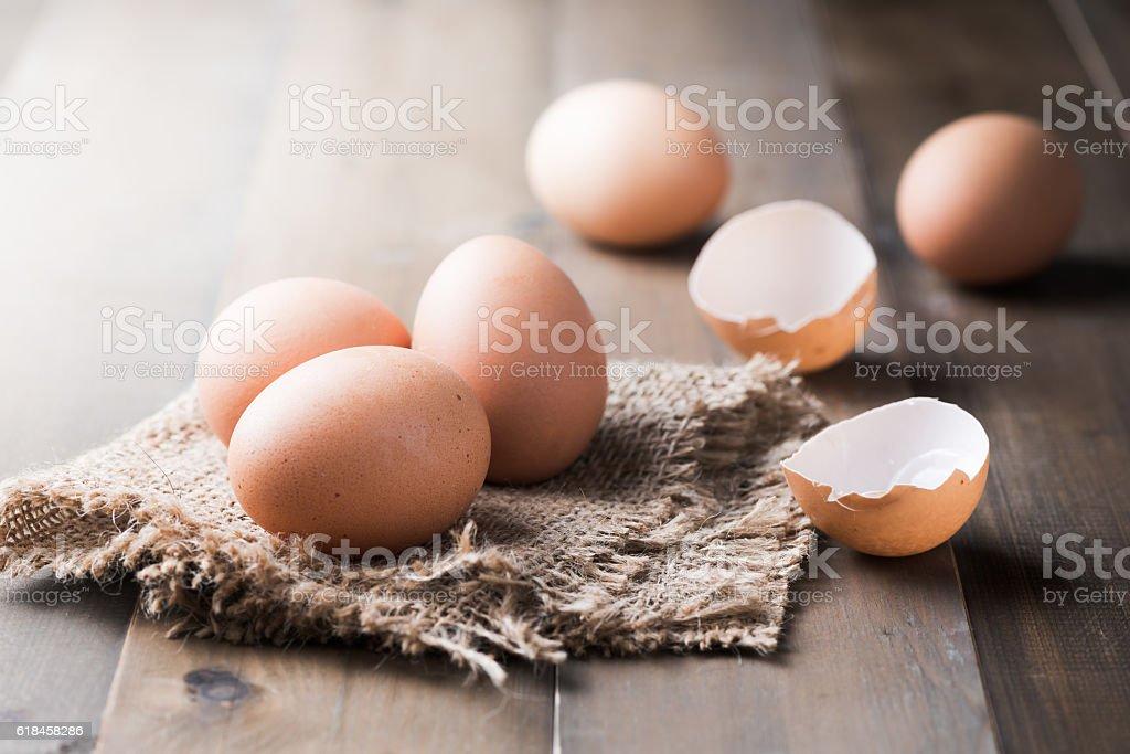 raw fresh egg on wood background stock photo