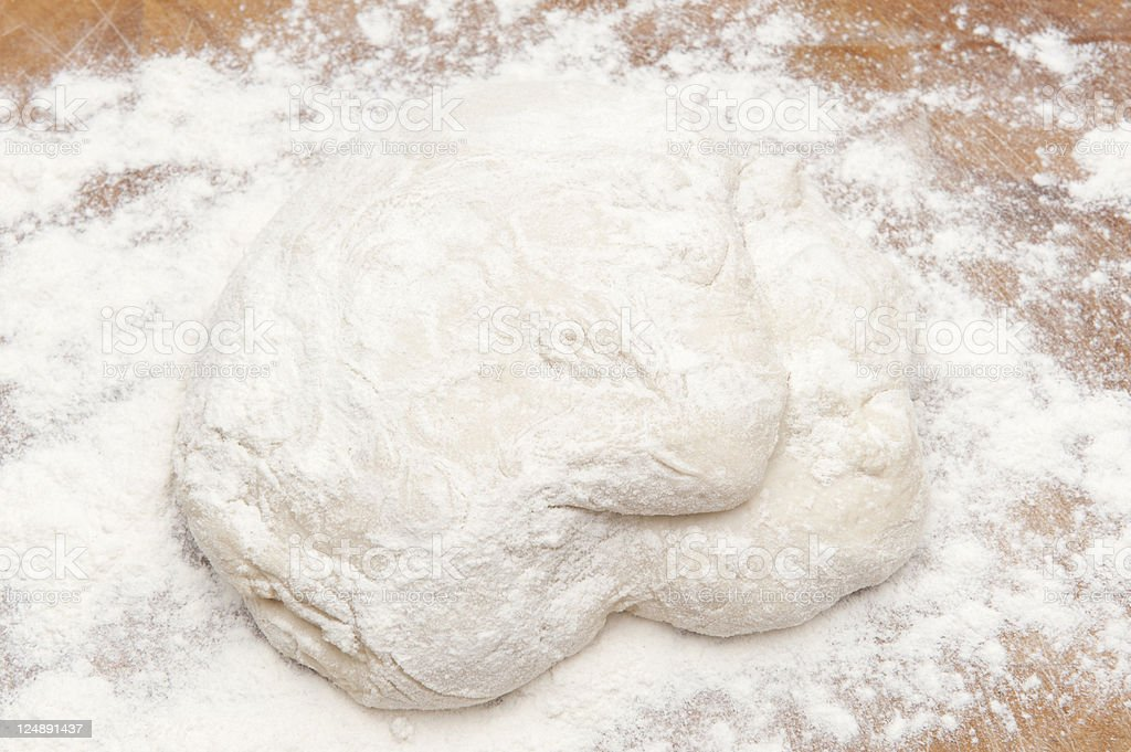 Raw Fresh Pizza Dough On Wooden Kitchen Counter royalty-free stock photo