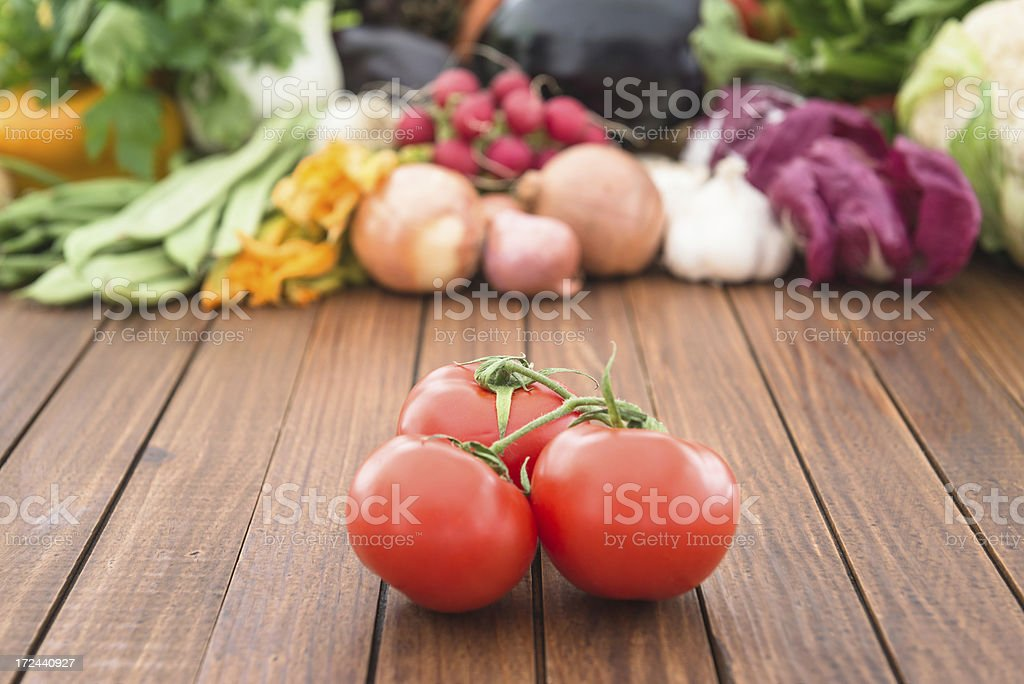 Raw fresh red tomatoes on wood royalty-free stock photo