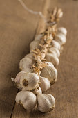 Raw garlic on a wodden table