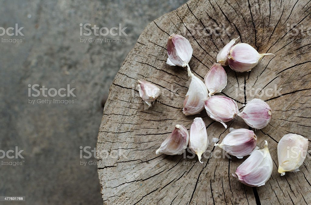 raw garlic on a wooden stock photo