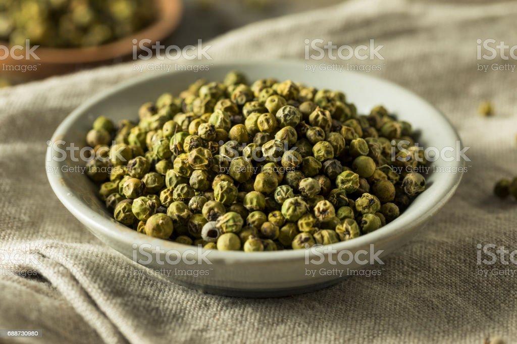 Raw Green Organic Peppercorns stock photo