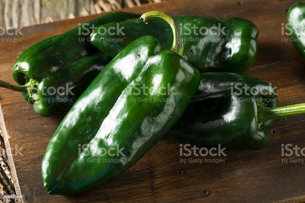 Raw Green Organic Poblano Peppers stock photo