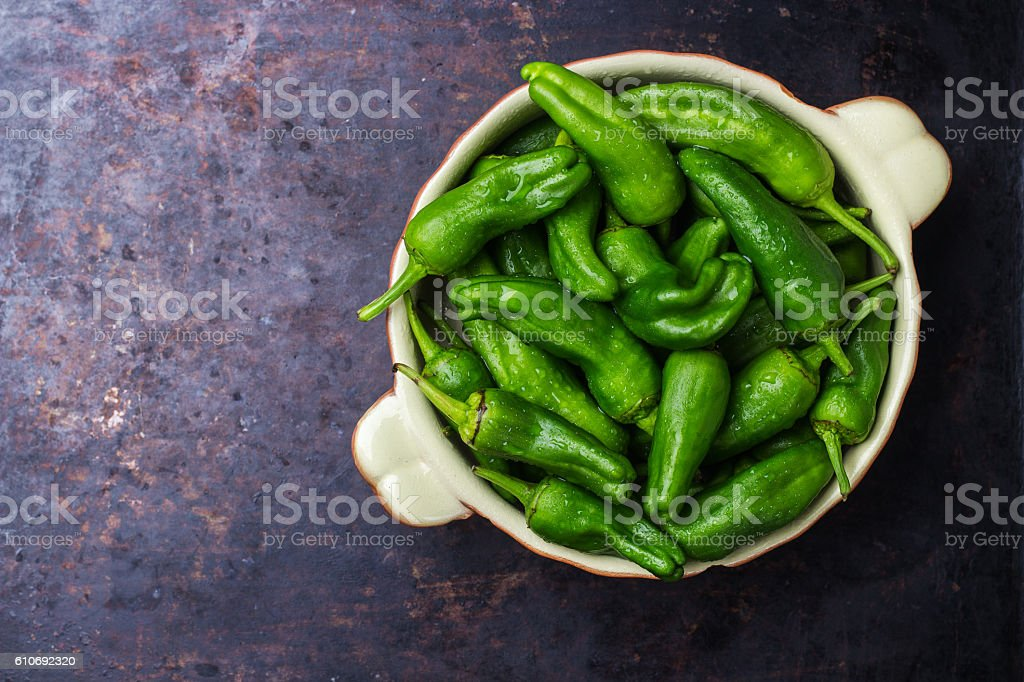Raw green peppers jalapeno pimientos de padron traditional spanish tapas stock photo