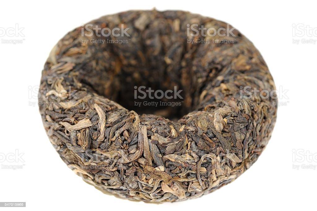 Raw green puerh tea bowl shape tuo cha closeup stock photo