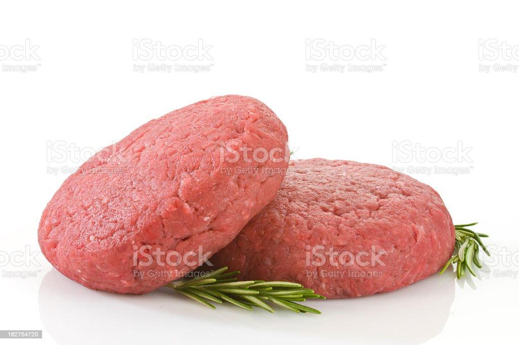 Raw hamburger patties against white background stock photo