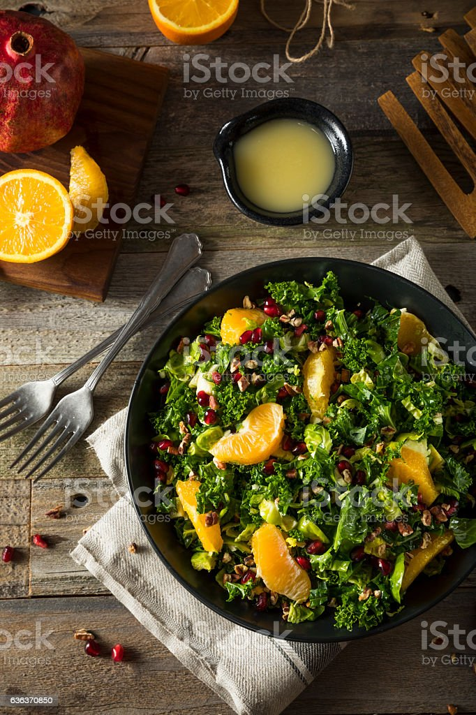 Raw Healthy Kale Winter Salad stock photo
