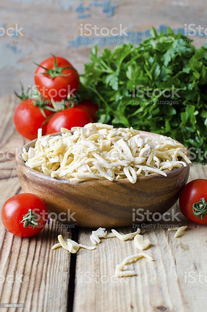 Raw, homemade pasta and vegetables stock photo