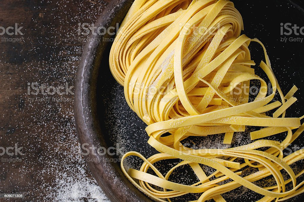 Raw homemade pasta tagliatelle stock photo