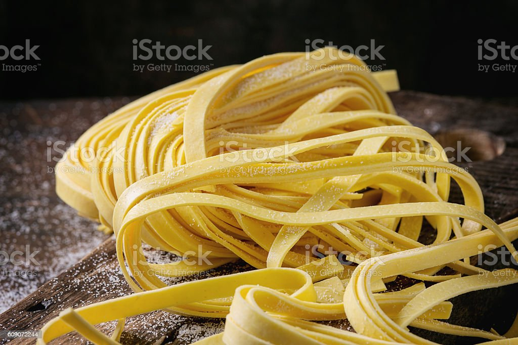 Raw homemade pasta tagliatelle stock photo