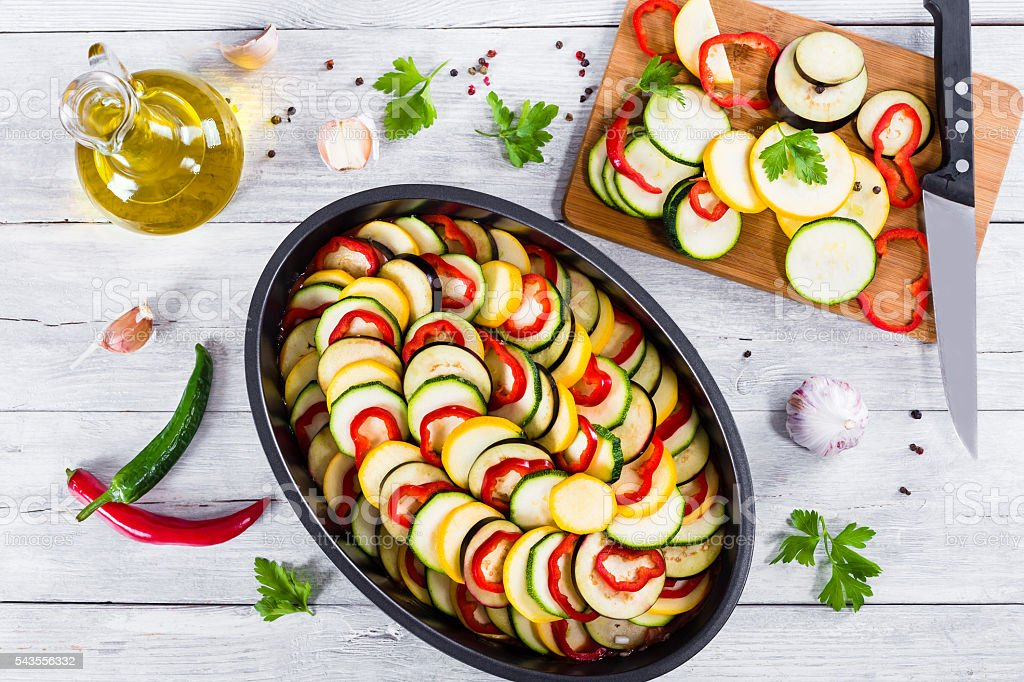 Raw ingredients for traditional French casserole, ratatouille to stock photo