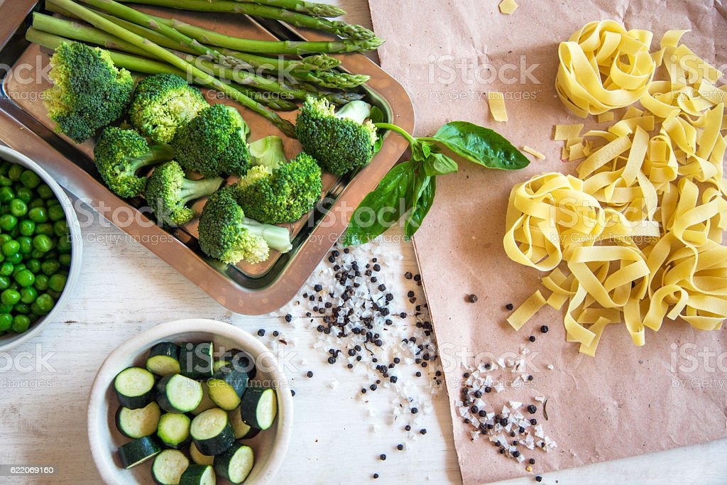 Raw ingredients for vegetarian pasta stock photo