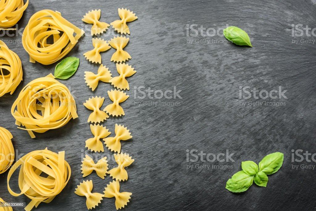 Raw italian tagliatelle and farfalle stock photo