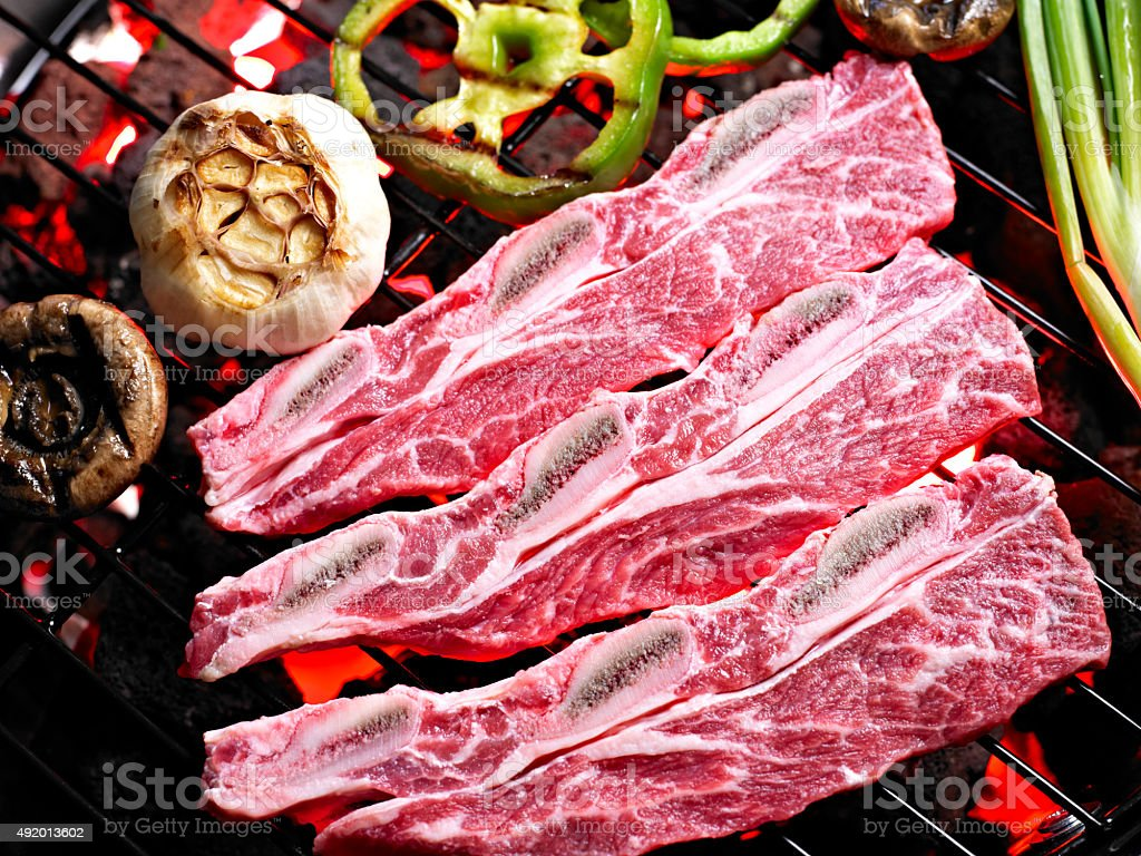 Raw Kalbi on Grill. stock photo