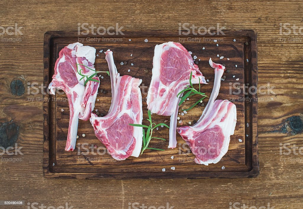Raw lamb chops. Rack of Lamb with rosemary and spices stock photo