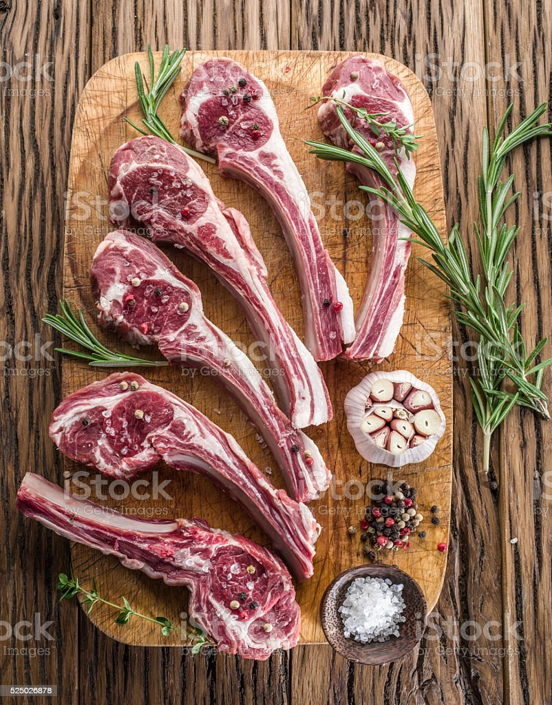 Raw lamb chops with garlic and herbs. stock photo