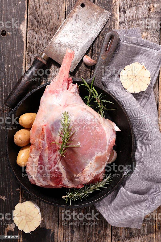 raw lamb leg with ingredient stock photo
