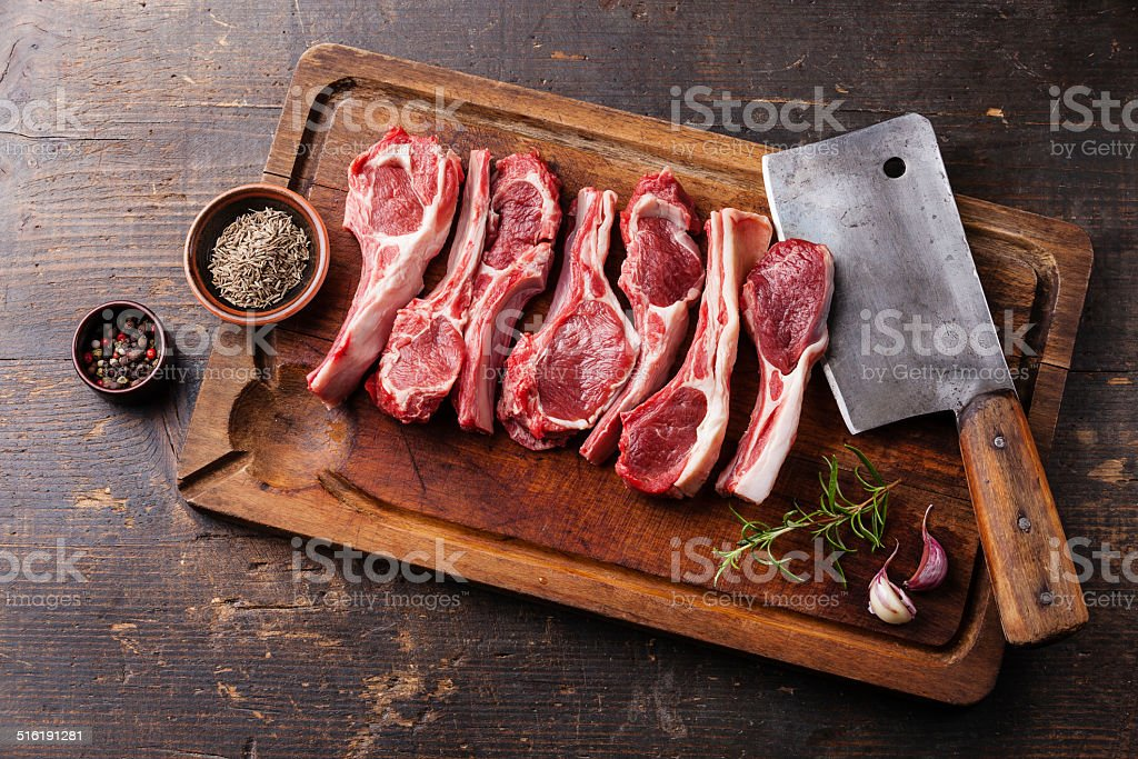 Raw lamb ribs and meat cleaver stock photo