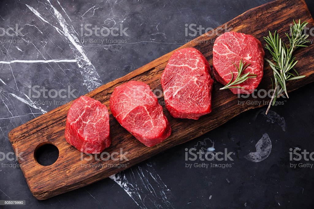 Raw marbled meat Steak and rosemary stock photo