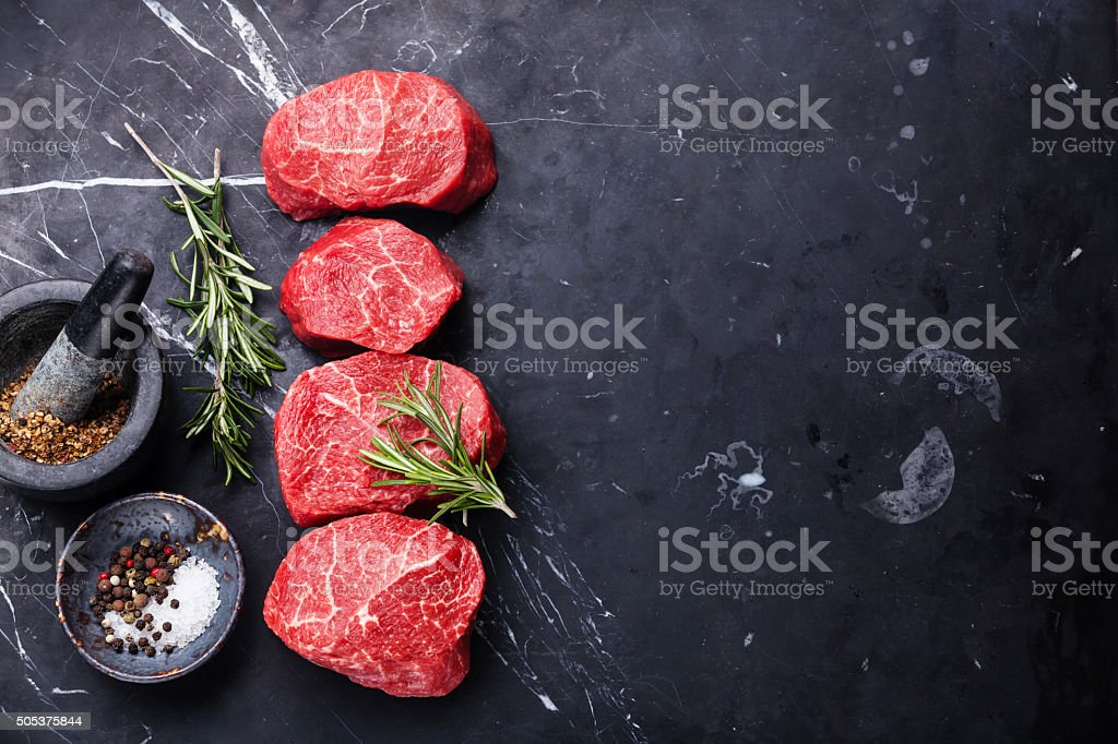 Raw marbled meat Steak and seasonings stock photo