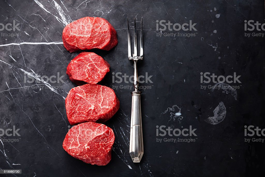 Raw marbled meat Steak filet mignon and fork stock photo
