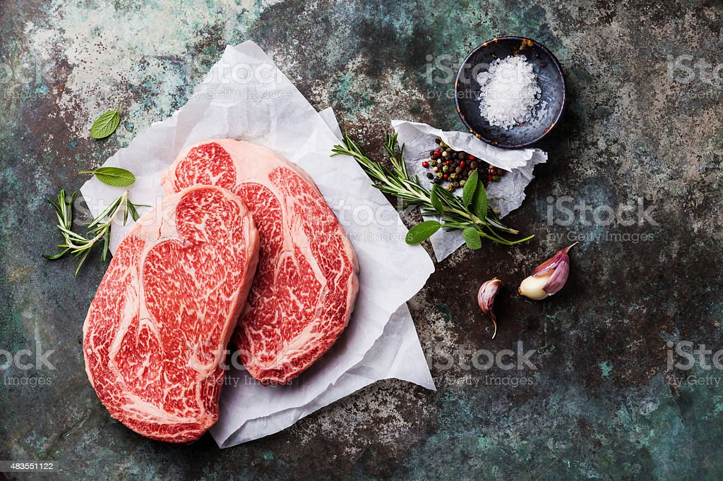 Raw marbled meat Steak Ribeye and seasonings stock photo