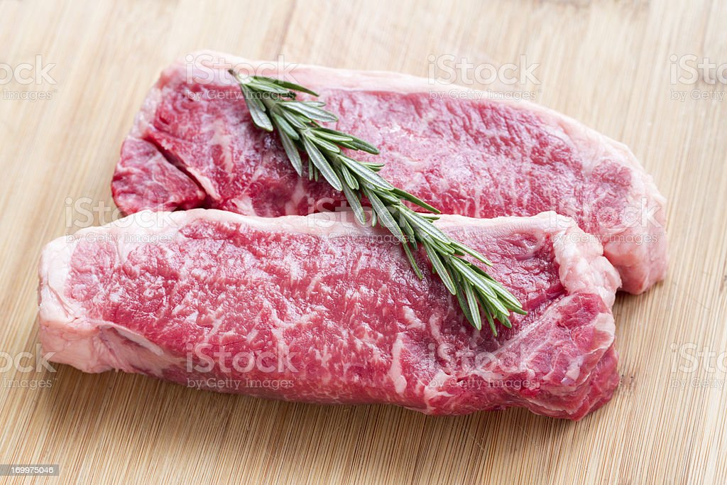 Raw Marbled New York Steaks stock photo