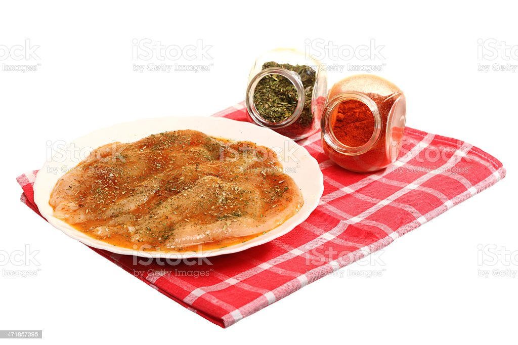 Raw marinated chicken breasts with spices royalty-free stock photo