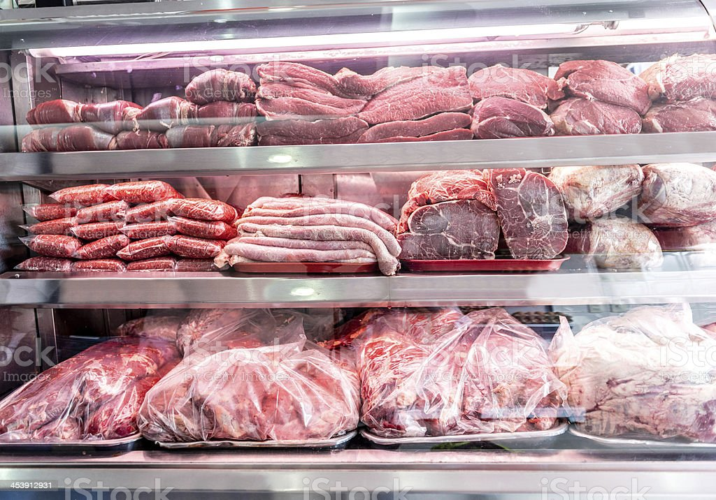 Raw meat at the butcher stock photo
