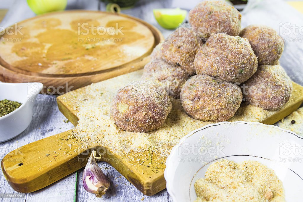 Raw meat balls minced beef rolled breadcrumbs royalty-free stock photo