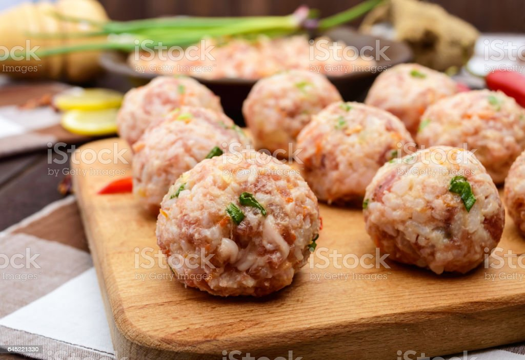 Raw meat balls, ready for cooking stock photo