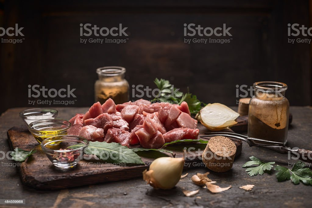 raw meat herbs spices on  cutting board on rustic background stock photo