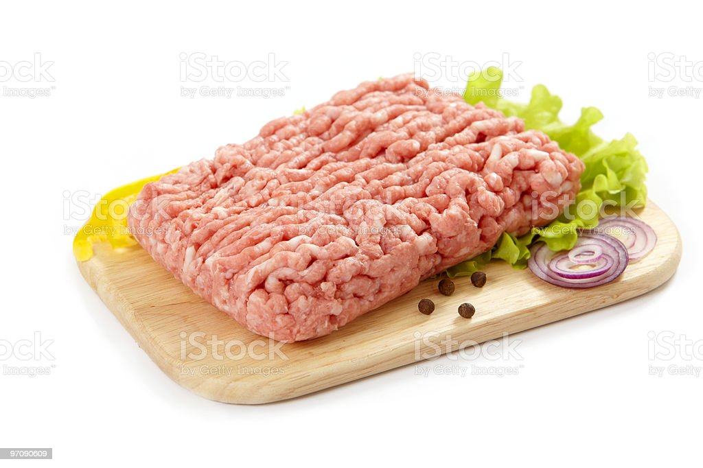 Raw meat on cutting board for preparation stock photo