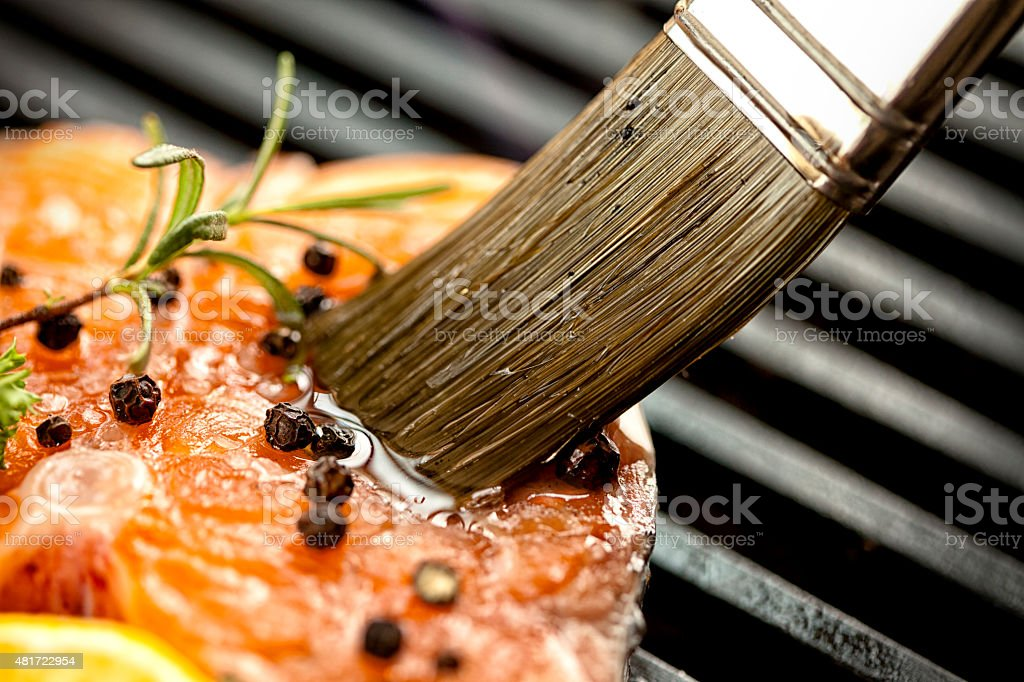 Raw meat on the grill stock photo