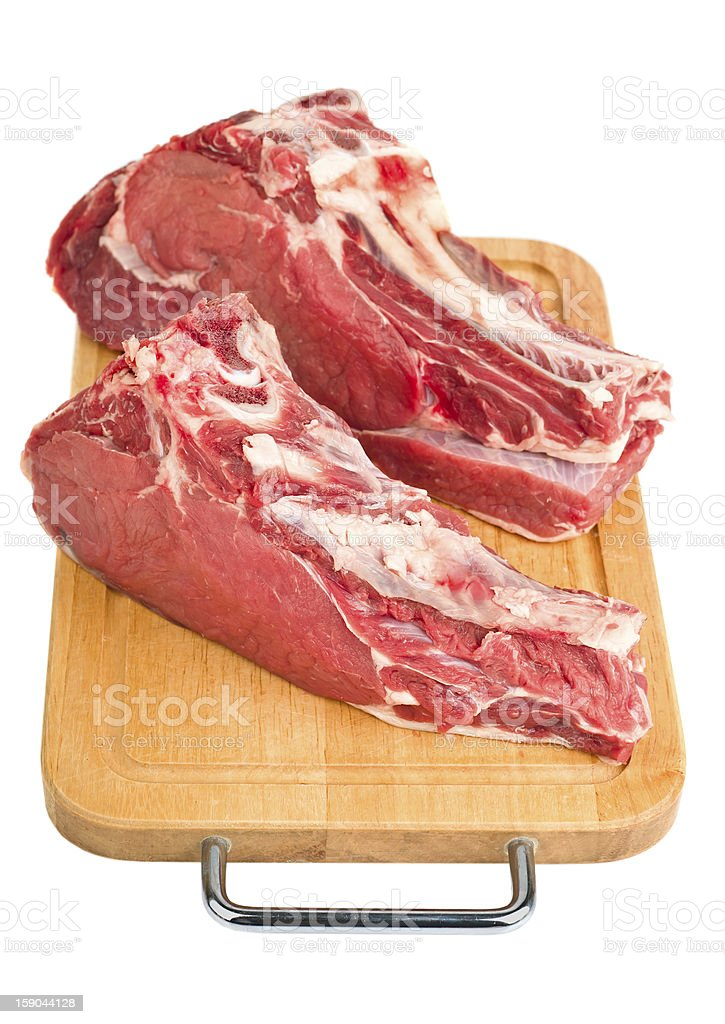 raw meat on wood board royalty-free stock photo